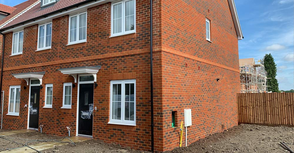 Cleaning scaffold banding (rash) at housing project in Banbury, Oxfordshire
